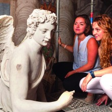 Kayla Metelenis '15 and Genna Asselin '15 examine a sculpture of Archangel Gabriel by Girolamo Campagna (1582) in the Monks' Loft of the church of San Sebastiano.