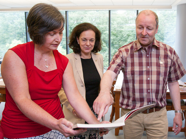 Elaine Stomber, associate College archivist, and Olga Duhl, Williams Professor of Languages, show La Fayette some documents in Skillman Library's Special Collections.