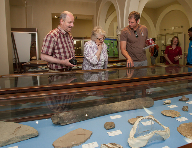 La Fayette and Michele Marinthe Vlahos tour the Arthur Montgomery Mineral Collection in Van Wickle Hall with geology professor David Sunderlin.
