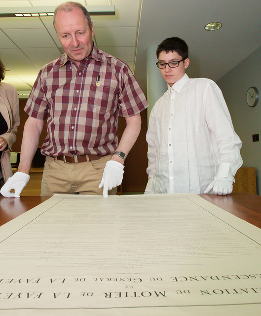 La Fayette and Alexander examine the numerous items related to the Marquis de Lafayette in Special Collections.