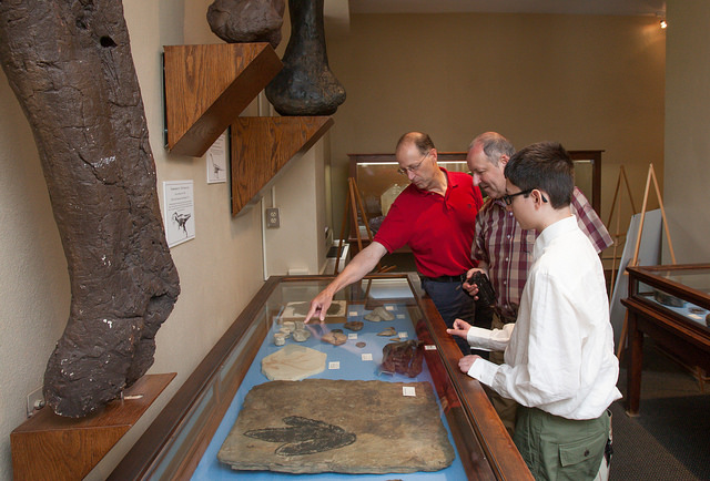 Geology professor Larry Malinconico shows the exhibits in the Arthur Montgomery Mineral Collection to La Fayette and his son, Alexander.