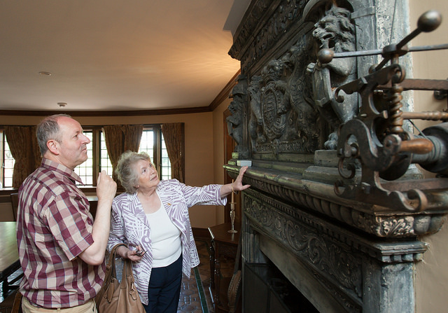 La Fayette and Michele Marinthe Vlahos examine the detailed woodwork at the Chateau Chavaniac.