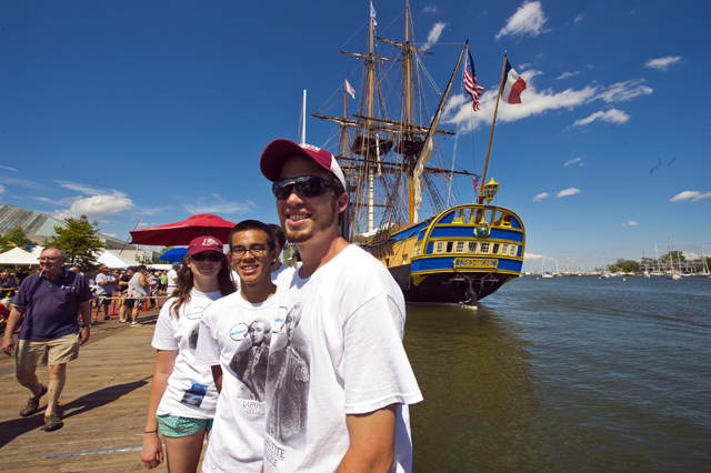 "The ""Be the Marquis"" student volunteers relax by the Hermione in Annapolis, Md."
