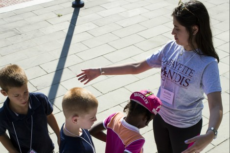 Ashley Ellis '16 measures campers for their t-shirts.