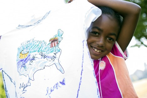 A happy camper shows off her artwork.