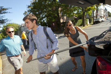 A new family unloads the car on McCartney Street.