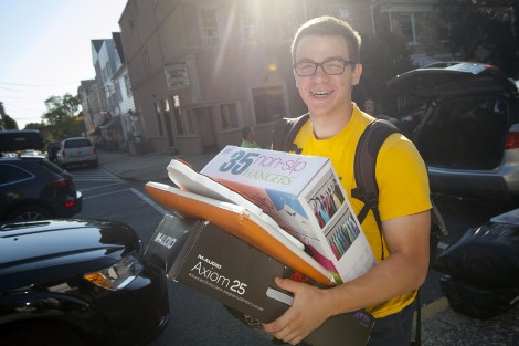 Jonathan Anastos '19 carries his things to his new hall.