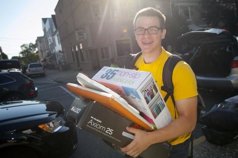 Jonathan Anastos '19 carries his things to his new hall.