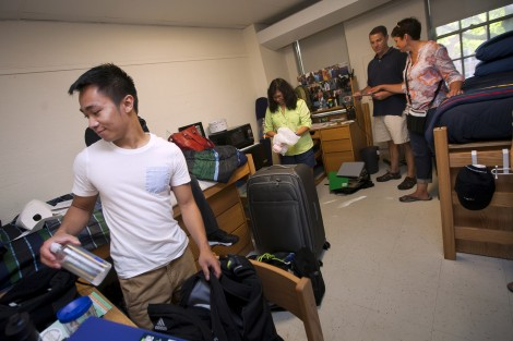 A new student sets up his room.