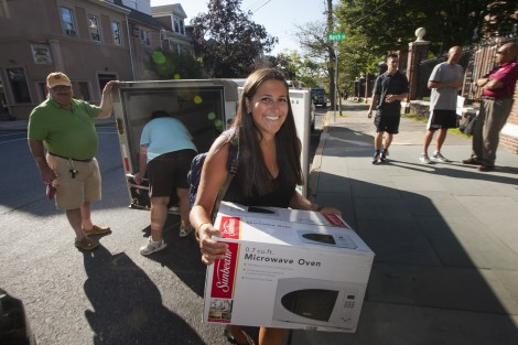 A new student unloads the U-Haul trailer.