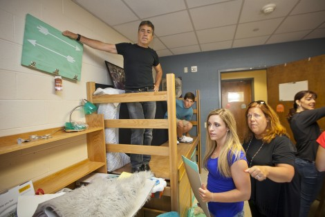 Alexandra Castiel '19 gets help setting up her room from her family.