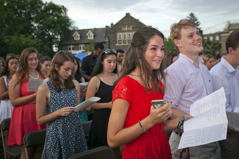 New students sing the alma mater for the first time.