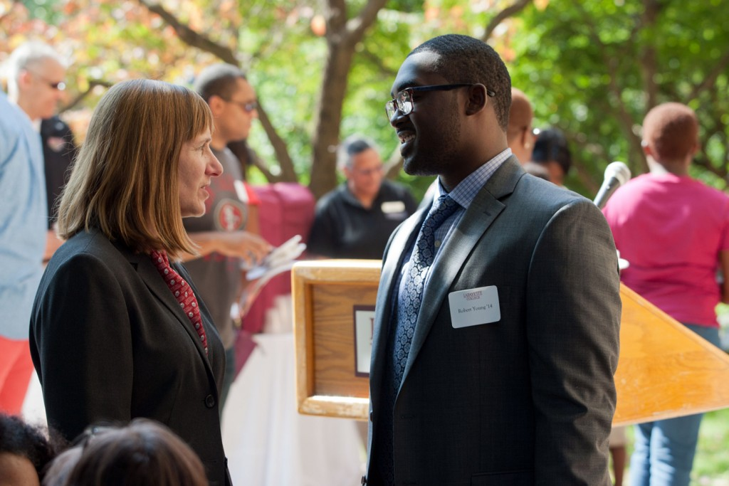 "President Alison Byerly speaks with Robert Young during the opening reception for ""Tales of Our Brothers: The Journey of David and Washington McDonogh."" Young curated the long-term exhibit featured in Pardee Hall."
