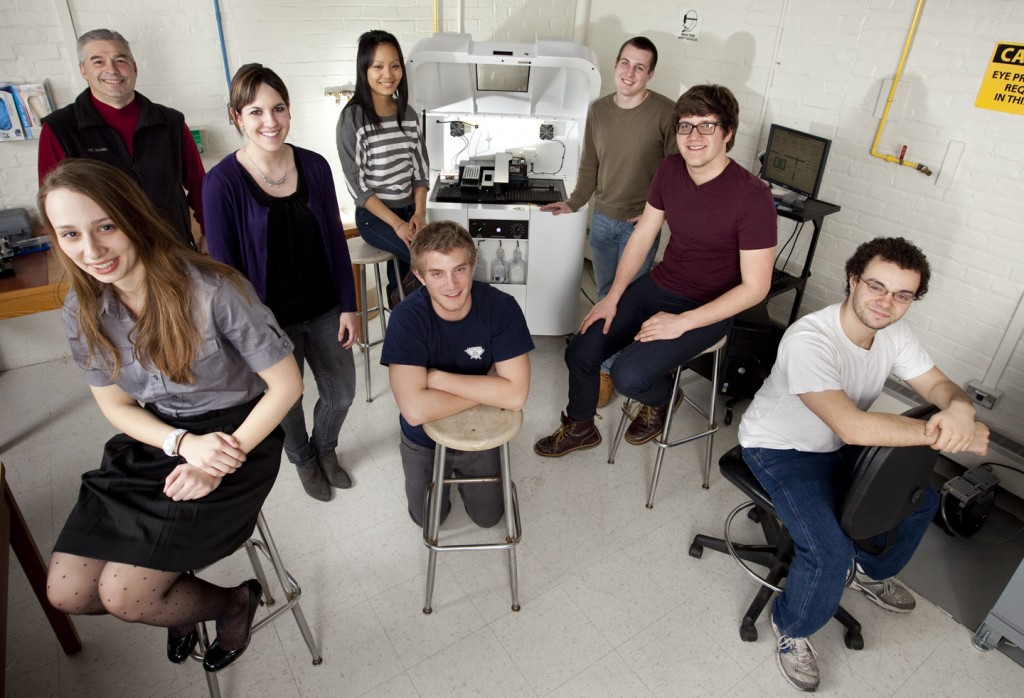 Colin Rementer '12, second from right, worked with the College's 3D printer in the chemical and biomolecular engineering senior design course.