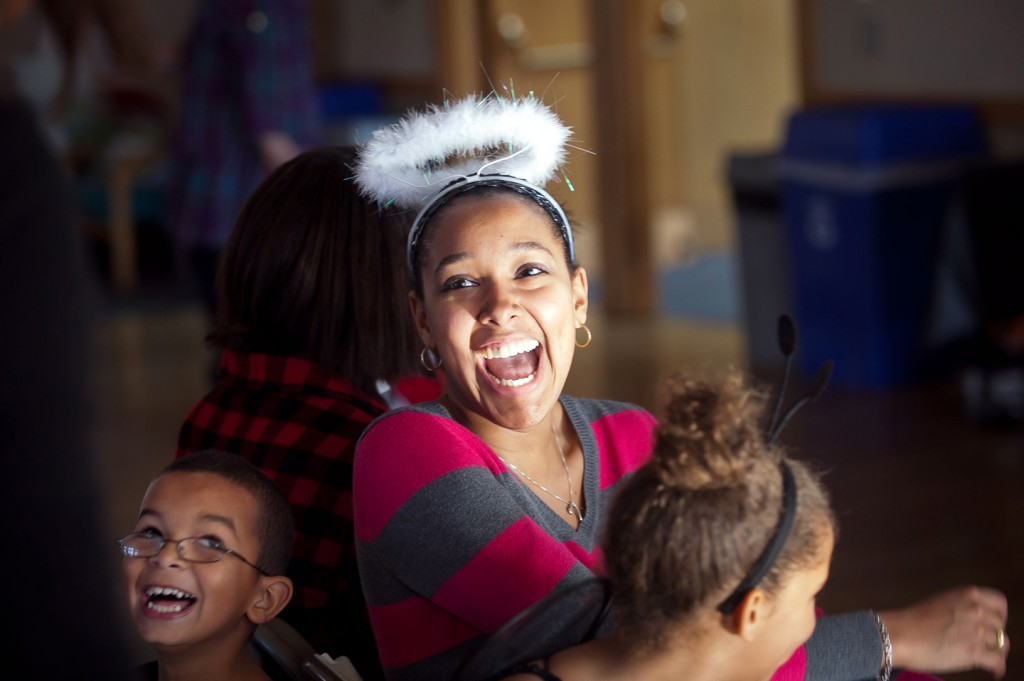 Jiselle Peralta '13 plays with children during the Single Motherhood course. The students held a Halloween party for Easton teen mothers and fathers.