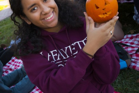 Patrice Gonzalez '19 presents her tiny pumpkin.