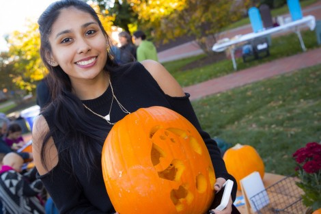 Luz Pineda '18 shows off her work.