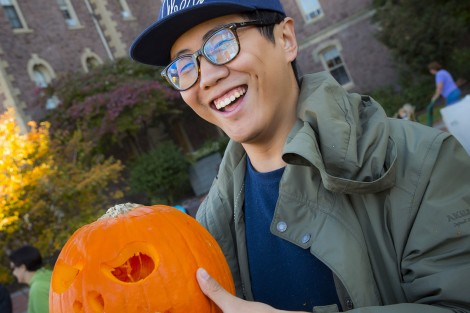 Leo Zhu '17 has some fun with his pumpkin.