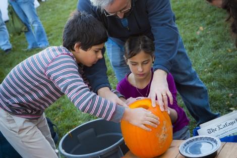 Professor Benjamin Cohen helps his kids Harper and Alexandra.