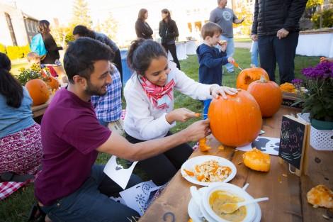 Taha Rohan '19 and Fatima Haidari '19 work on a pumpkin together.
