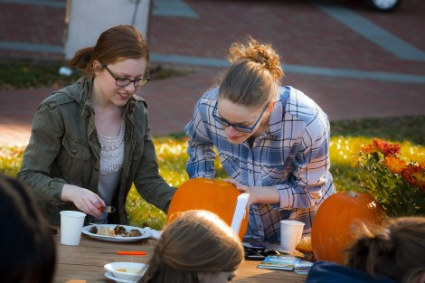 Andrea Mitchell '18 and Emma Glubiak '18 take care of some little details.