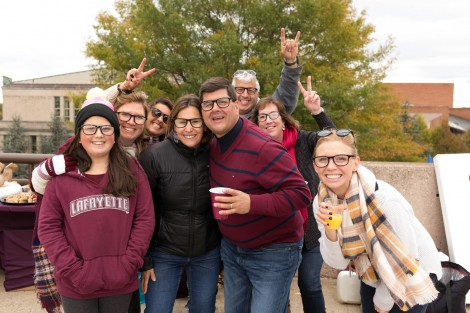 "Students, alumni, and families put on their ""Joe Maddon glasses"" in support of the alumnus and Cub's manager's run in the Major League Baseball playoffs. Photo by Clay Wegrzynowicz '18"