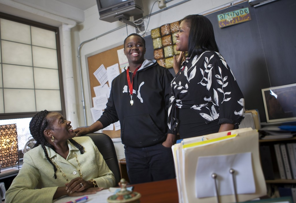 Pat Myers '82 (left) talks with Stephon Littles, senior class president, and Khaliah Thomas at South Philadelphia High School, where she mentors students regarding careers in engineering and other technological fields.