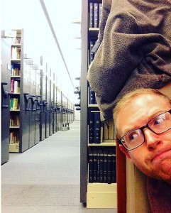 Ryan Burke '16 pokes his head out of his study spot in Skillman.