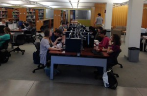 Students fill the study tables at Skillman Library.