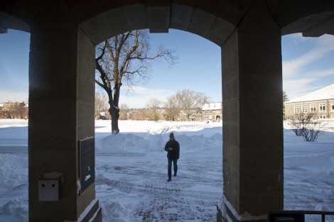 A student enters the back entrance of Pardee Hall.