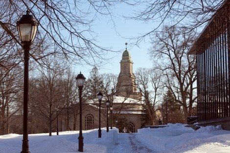 A student walks toward Skillman Library with Colton Chapel in the background.
