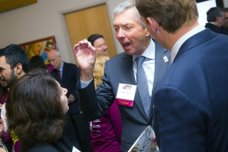 Stephen Pryor '71 (center) chats with Pamela Passman '83 and Kevin Mandia '92.