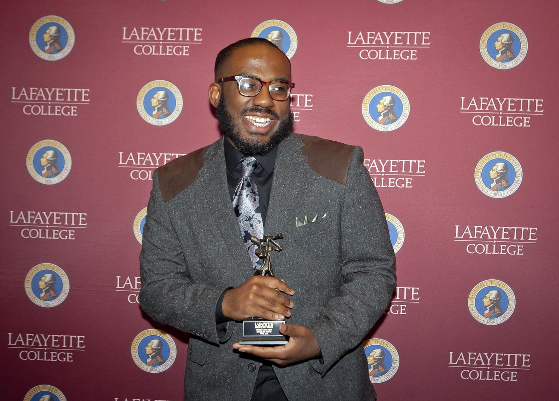 Charles Evans '19 receives the Emerging Leader Award.