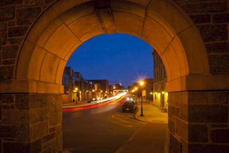 A view of the Williams Arts Campus at dusk from the arch on Third Street