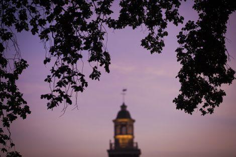 The steeple of Watson Hall in purple sunset