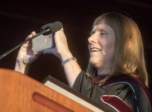 President Alison Byerly takes a photo of the new class to post on Twitter.