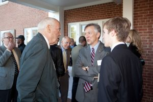 Students and alumni mingle at the house dedication ceremony.