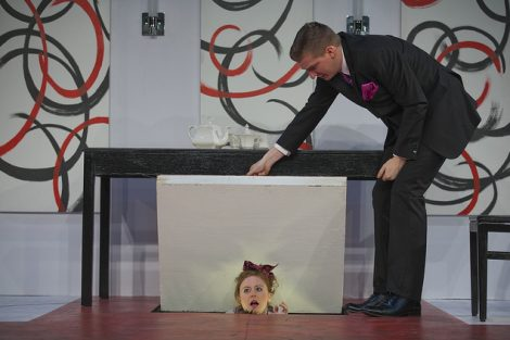 Two students act on stage in a scene from the Lafayette production of the play Tartuffe.