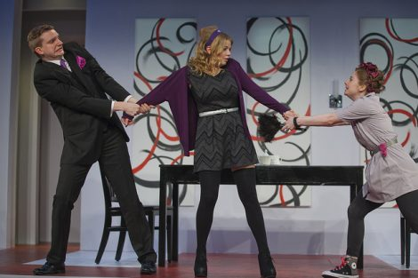 Three students act on stage in a scene from the Lafayette production of the play Tartuffe.
