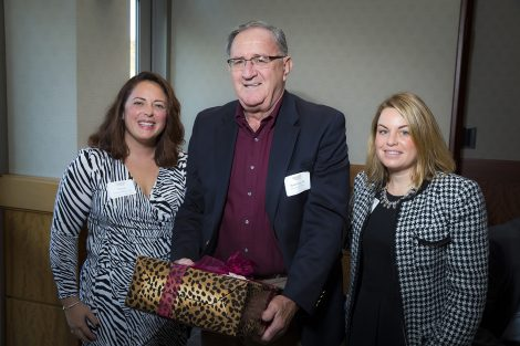 The Ernest G. Smith Award went to The Class of 1966. Receiving the award is Paul O'Hea '66 with Meghan Morici '06, director of annual giving, and Courtney Fein, assistant director.