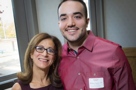 Lisa Kassel '79, president of Alumni Association, presents the Chapter Support Person of the Year to Matthew Pagano '09.
