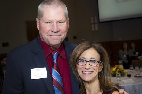 Michael McClintock '71 received The Woodring Volunteer of The Year Award from Lisa Kassel '79, president of Alumni Association.