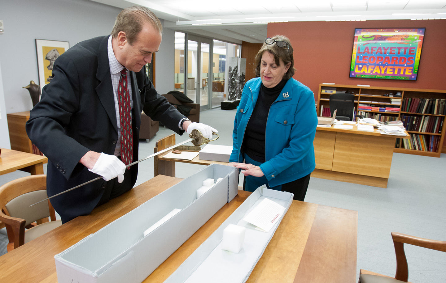 Dimitri Villard examines the Marquis de Lafayette's sword with Diane Shaw.
