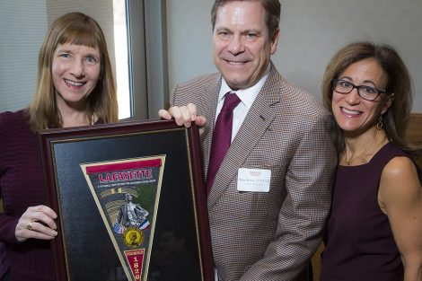 President Byerly presents The Bell Award to J. Peter Simon '75 with Lisa Kassel 79, president of the Alumni Association.