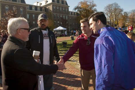 Joe speaks with students on the Quad.