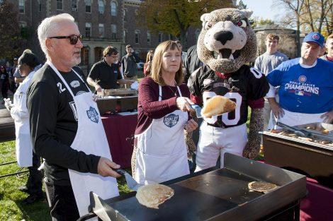 President Byerly flips a pancake.