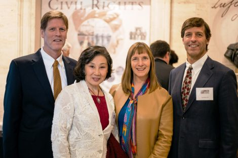Dillard Kirby '81, painter Ying-He Liu, President Byerly, and Jeff Kirby '84 mingle at a reception for the unveiling.