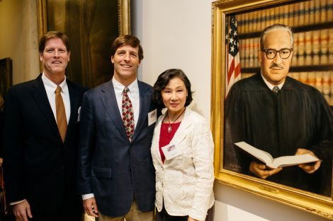 Dillard Kirby '81, Jeff Kirby '84, and painter Ying-He Liu with the new portrait