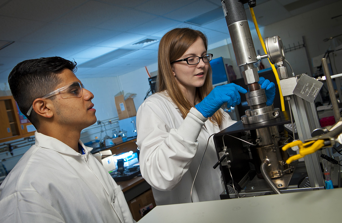 Luce Scholar Eddalee Hochwalt Naumann '19 and Praphulla Pokharel '19 work on the supercritical CO2 reactor.
