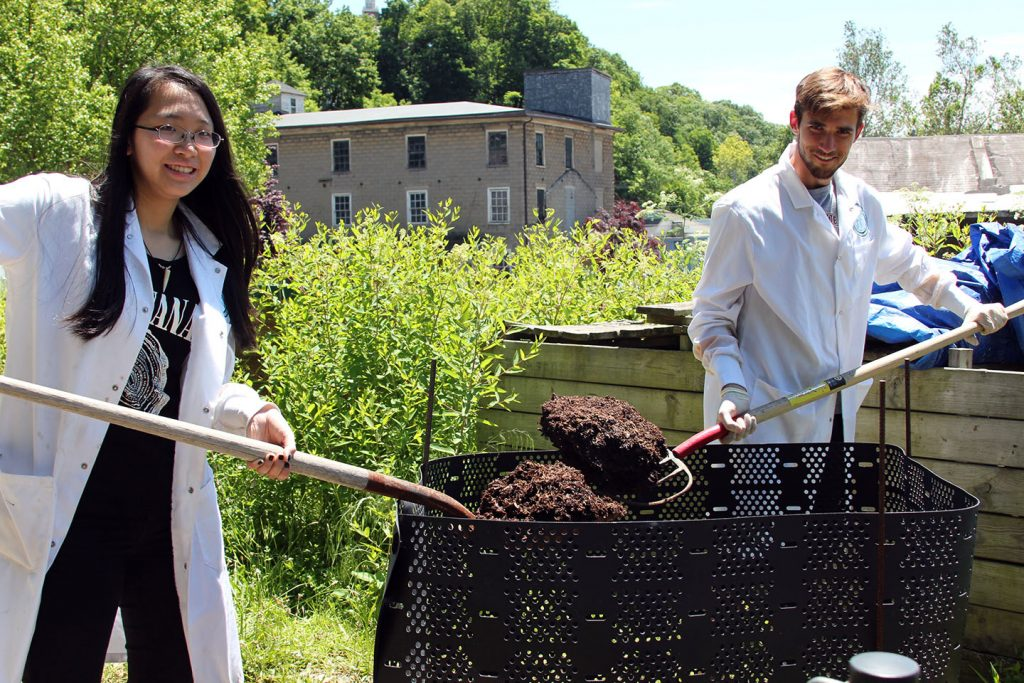 Cathy Ye '17 and Campbell Weyland '17 work with organic compost.